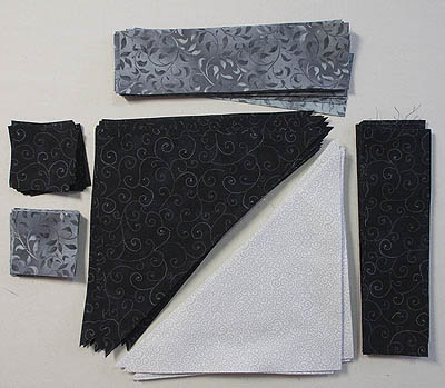 Several rectangles, squares and triangles in grey, white and black