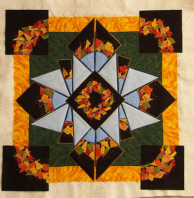 Corner squares set out from yellow border with wreath in line with yellow border