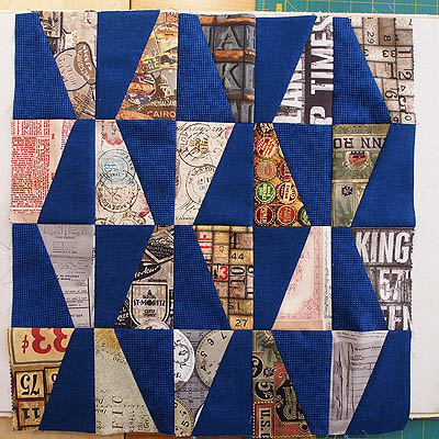a pillow cover made from blue and eclectic fabrics