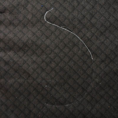 White lines on black fabric - part of the J design