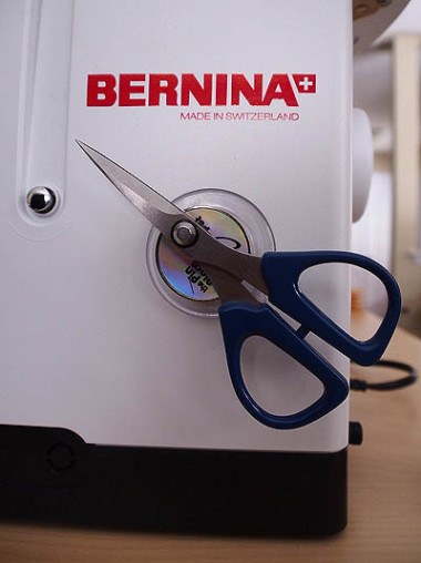Scissors attached to machine with the magnetic spot