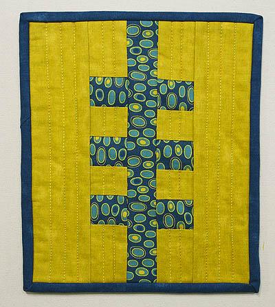 Railroad Tracks mug rug in teal/blue and mustard yellow