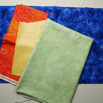 Blue, orange, yellow and green fabrics