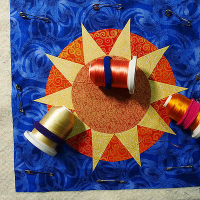 Three spools thread on the sun