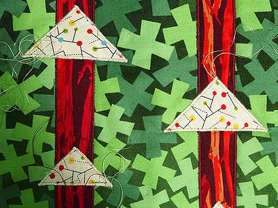 Cream satin stitch on triangles