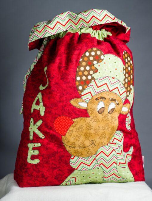 Red santa sac with Rudolph applique